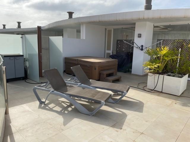 impresionante duplex en venta en palm mar con jacuzzi exterior privado PM2026